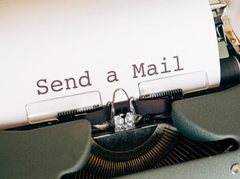 Typewriter displaying Send a Mail