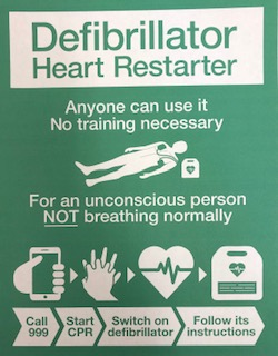 Image text: Defibrillator Heart Restarter. Anyone can use it. No training necessary. For an unconscious person NOT breathing normally call 999, start CPR, switch on defibrillator, follow its instructions.
